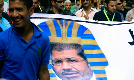 Said UK's Guardian: Egyptian protesters hold a banner depicting President Mohamed Morsi as a pharaoh during a demonstration over his presidential decrees. Photograph: Andre Pain/EPA