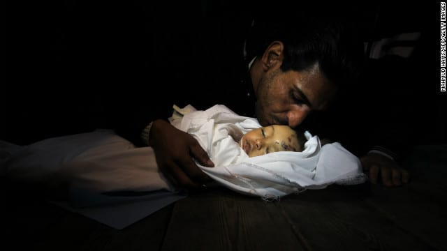 Palestinian father kisses goodbye baby girl killed by an Israeli airstrike. While Israelis also suffer occasional casualties, the ratio of dead and wounded is grotesquely against the Palestinians, a reflection of their lack of heavy weapons, including tanks, air force, a navy and so on, not to mention extremely sophisticated rocket delivery systems.