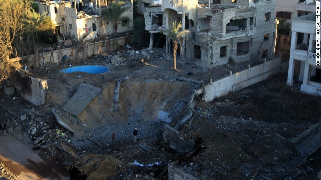 Israeli bomb crater in Gaza. The density of population in this territory makes all attacks by practically unchallenged air power an act of wanton murder against civilians..literally shooting fish in a barrel.