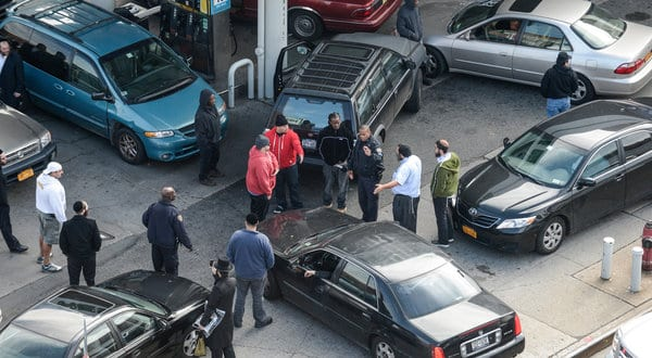 Sandy's social strains: arguing over scant gasoline supplies.