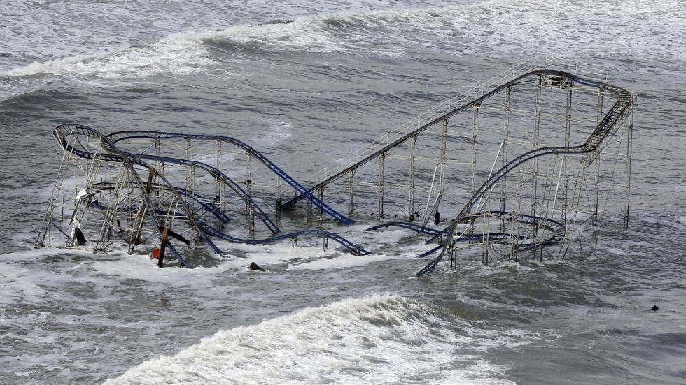 Waves wash over a roller coaster from a Seaside Heights, N.J. amusement park that fell in the Atlantic Ocean during superstorm Sandy on Wednesday, Oct. 31, 2012. (AP Photo/Mike Groll)