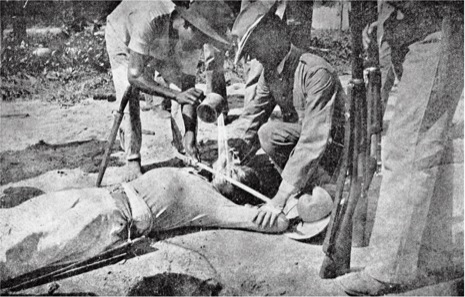 "Marines administering the ""water cure"" to a filipino rebel in 1901. US imperial atrocities are old."
