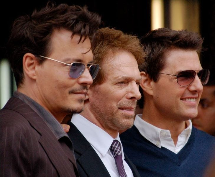 Bruckheimer flanked by two of his protégés—Depp and Cruise.
