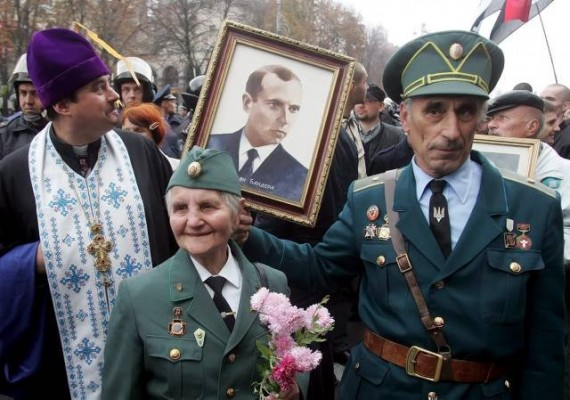 Veterans of the Ukrainian Insurgent Army (UPA) a fascist, ultranationalist formation, hold portrait of Stepan Bandera.