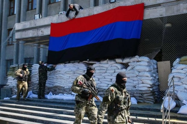 Donetsk Republic Flag hangs from sepaatist-controlled building.