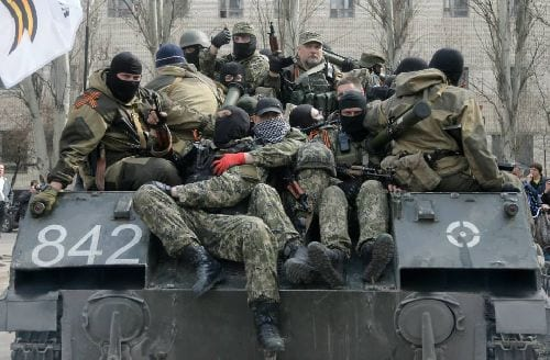 Soldiers in Slovyansk today wearing St. George ribbons. These are ribbons that celebrate the joint victory of the east and west against Nazi Germany and are widely regarded as an opposition symbol against the coup government. These military units, sent to crush protests, have joined the side of the uprising in eastern Ukraine.