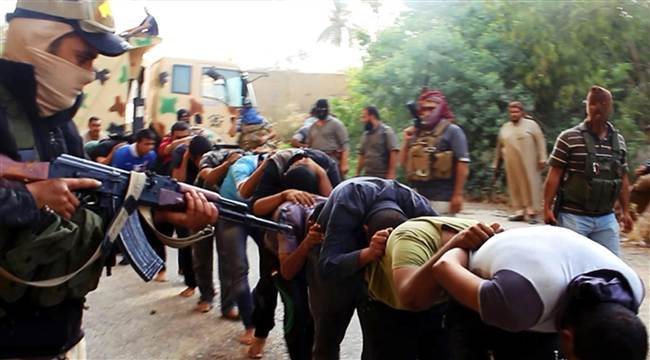 This image posted on a militant website on Saturday, June 14, 2014, which was provided by AP and has not been verified by NBC News, appears to show militants from the al-Qaeda-inspired Islamic State of Iraq and the Levant (ISIS) leading away captured Iraqi soldiers dressed in plain clothes after taking over a base in Tikrit, Iraq.