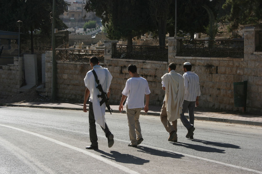 """SettlersShuhadaStreet"" by ISM Palestine - Flickr: Settlers taking a walk on Shuhada Street. Licensed under Creative Commons Attribution-Share Alike 2.0 via Wikimedia Commons - http://commons.wikimedia.org/wiki/File:SettlersShuhadaStreet.jpg#mediaviewer/File:SettlersShuhadaStreet.jpg"