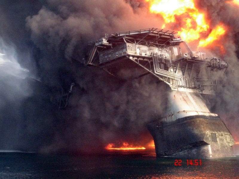 Deepwater oil rig inferno. Cutting a few dollars begets a catastrophe for man, beast and the environment.  (Click to enlarge.)