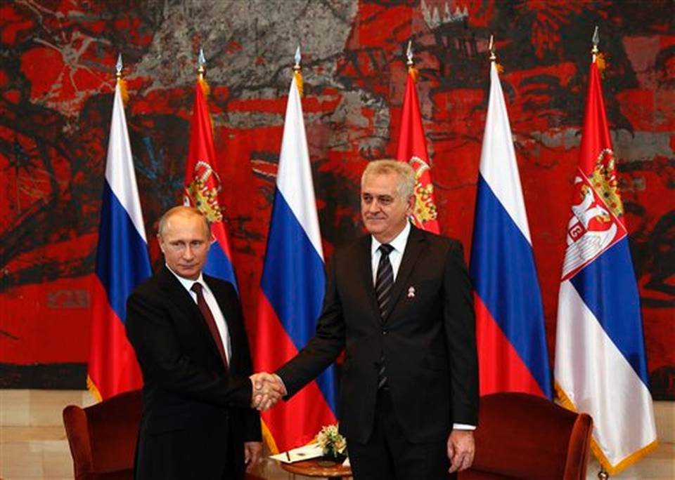 President Putin in Serbia, shaking hands with his host. / click to expand
