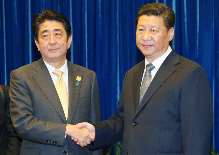 Japan's PM Abe and China's President Xi Jinping do the obligatory handshake at the APEC Conference. Abe is an out and out reactionary happy to implement US warmongering policies in the region.