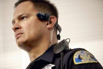 Pictured is San Jose Police Department officer Michael Ceballos wearing a video/audio recording device during a press conference at SJPD headquarters on Dec. 18, 2009. Since November of last year, the San Jose Police Department has been working with the Taser International Corporation as Taser has been designing a video/audio device that patrol officers could wear in the field to capture details of what is occurring as they handle calls for service. The device, known as the AXON device, is now ready to be deployed, and SJPD will be working with Taser on a pilot project to test the devices in the field. (Dai Sugano/Mercury News)