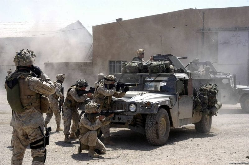 U.S. Marines from 1st Battalion, 5th Marines fire at insurgent positions during the First Battle of Fallujah.