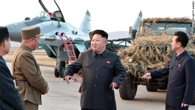 Kim Jong-Un (C) inspects a flight drill by the Korean People's Army (KPA) Air and Anti-Air Force, at which units 1017, 447 and 458 of the KPA took part, at undisclosed location in North