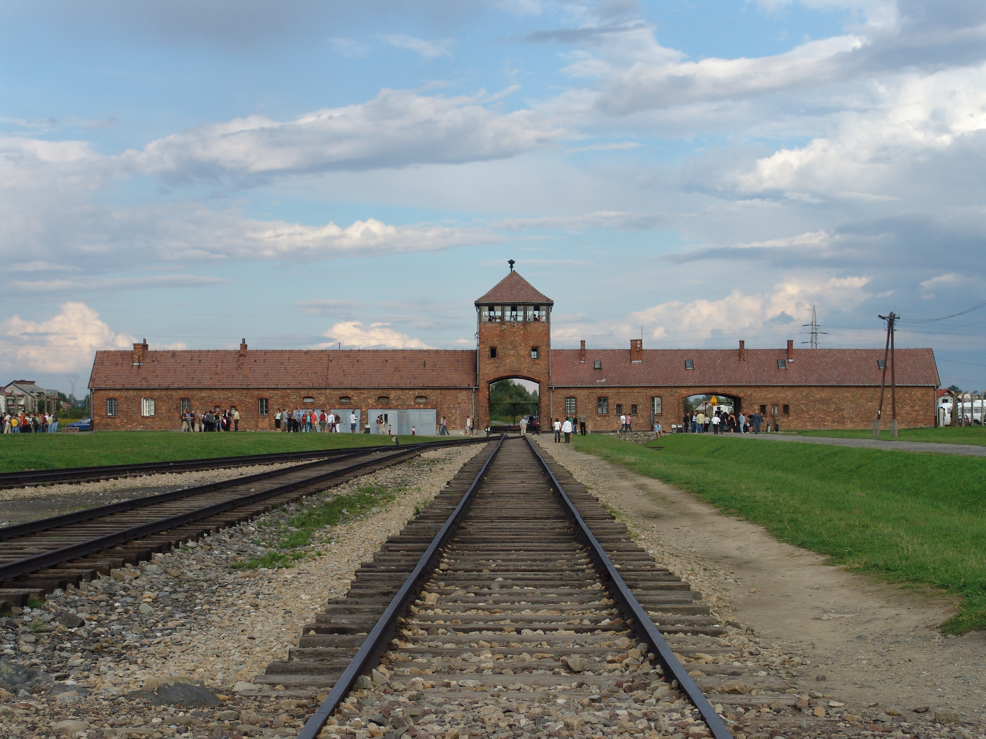 """The main gate at the former German Nazi death camp of Auschwitz II (Birkenau). Note that this is inside the camp looking back from the loading ramp to the """"Gate of Death"""". (Creative Commons CC-BY-SA-2.5)"""