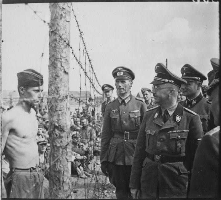 SS chief Heinrich Himmler inspects a camp for Soviet prisoners of war. 1941. Afforded no protections under international conventions, the German army felt free to treat Soviet prisoners despicably, as animals. 3.5 million died in captivity. (US National Archives)