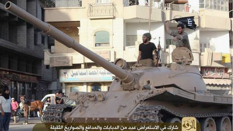 ISIS militants with captured tank.