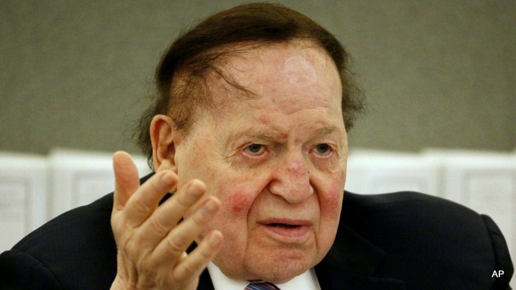 FILE - In this May 4, 2015 file photo, Las Vegas Sands Corp. Chairman and CEO Sheldon Adelson testifies in court in Las Vegas. A news organization and nonprofit group want a Nevada judge to unseal a private investigator's report that they say may tie casino company Las Vegas Sands Corp. to organized crime in Asia. The Campaign for Accountability says in its motion filed Monday, June 8, 2015, that it also wants to see the rep