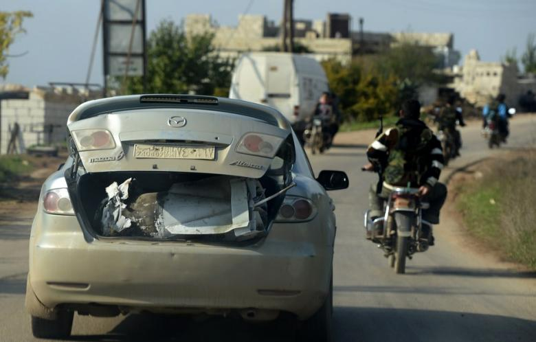 "Syrian ""rebels"" carrying bomb in car trunk. In the open as the Turkish border with Syria is not properly patrolled by Turkey to precisely permit such hostile infiltration."