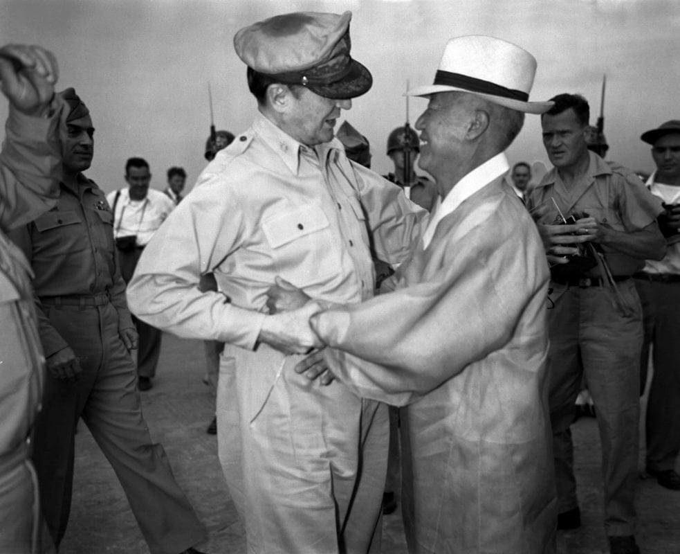 Washington's handpicked puppet, Syngman Rhee, embraces his lord protector, Douglas MacArthur, Supreme Commander for Allied Powers. MacArthur was a hardcore reactionary who went so far he had to be restrained by Truman.