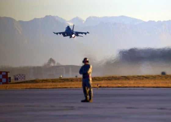 A U.S. Air Force F-16 Fighting Falcon aircraft departs Aviano Air Base, Italy, during a close air support training exercise Dec. 17, 2013. Italy is today a gigantic American aircraft carrier in the middle of the Mediterranean. (USAF photo)