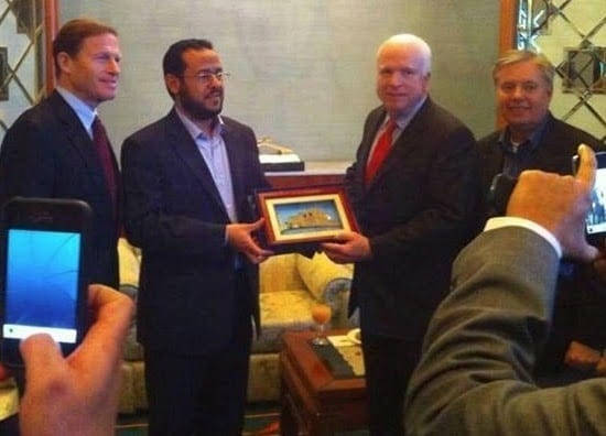 John McCain proudly standing with Abdelhakim Belhadj, with the equally reprehensible Lindsey Graham in tow.