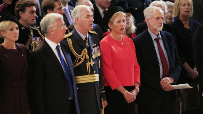 The leader of Britain's opposition Labour party Jeremy Corbyn, right, stands for the national anthem during  the 75th anniversary Battle of Britain memorial service at St Paul's Cathedral in London, Tuesday, Sept. 15, 2015. The Battle of Britain was an aerial battle in World War II between Allied air forces and the German Luftwaffe in the late summer and early autumn of 1940. (Pool Photo/via AP)