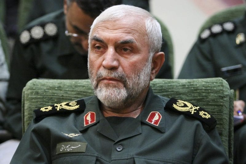 """In this Dec. 9, 2009 photo, released by Iranian Tasnim News Agency, Iranian Revolutionary Guard Gen. Hossein Hamedani sits in a meeting in Tehran, Iran. Hamedani, a senior commander in Iran's powerful Revolutionary Guard was killed by Islamic State extremists on the outskirts of the northern Syrian city of Aleppo, Iranian state media reported on Friday. A state television report said that Gen. Hossein Hamedani was killed in the suburbs of Aleppo while """"carrying out an advisory mission.""""  (AP Photo/Tasnim News Agency, Hamed Malekpour)"""