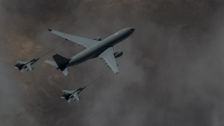 RAF Tornado bombers being refueled in mid-air. The craft is being sent to Syria—the bombing is of course illegal.