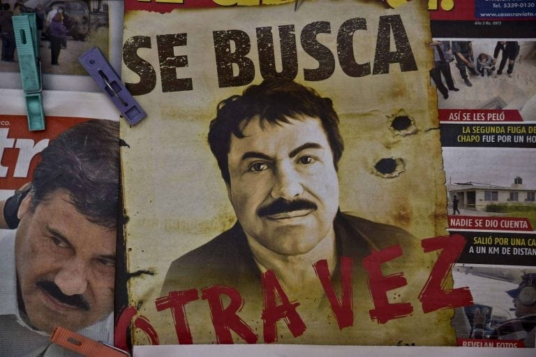 """TOPSHOTS A poster with the face of Mexican drug lord Joaquin """"El Chapo"""" Guzman, reading """"Wanted, Again"""", is displayed at a newsstand in one Mexico City's major bus terminals on July 13, 2015, a day after the government informed of the escape of the drug kingpin from a maximum-security prison. Mexican security forces scrambled Monday to save face and recapture """"El Chapo"""" as authorities investigated whether guards helped him escape prison through a tunnel under his cell.   AFP PHOTO / YURI CORTEZ"""