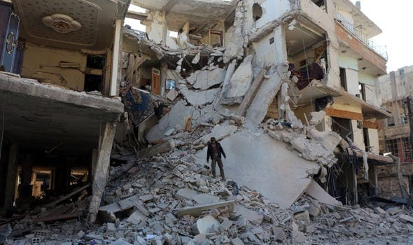 anti-Russia-Debris-of-a-collapsed-building-after-a-Russian-air-strike-in-Damascus-489169