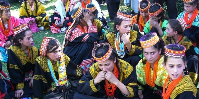 Women and girls from the Kalash community still wear colourful traditional costumes.Image: Ground Report via Flickr