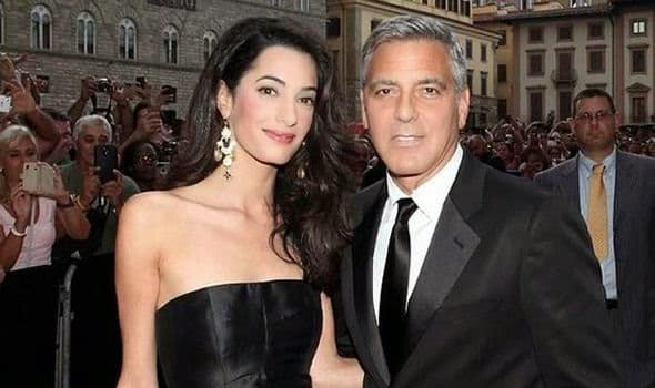 Clooney with his new bride. For a long time Clooney has been notorious for his Hollywood brand of liberalism, and shilling for the empire. Whether he's just alarmingly ignorant , naive, or corrupt is still a good question.  See Appendix below.