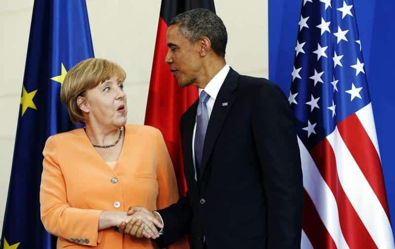U.S. President Barack Obama and German Chancellor Angela Merkel shake hands at the end of a joint news conference at the Chancellery in Berlin June 19, 2013.REUTERS/Kevin Lamarque (GERMANY - Tags: POLITICS)