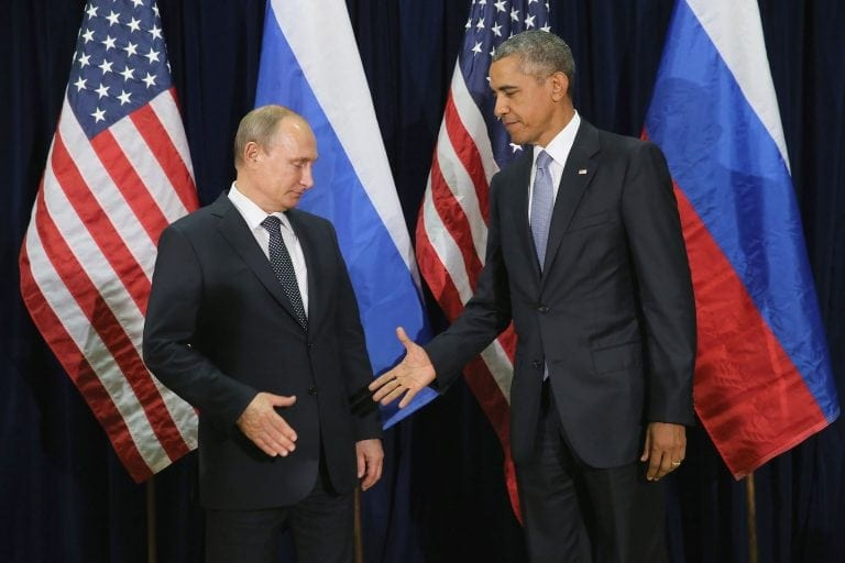 Russia's president Vladimir Putin looks dubious about shaking Obama's hand in New York in 2015. He should be. Count your fingers afterwards, Vladimir.