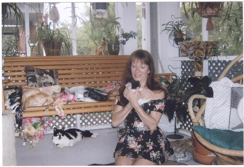Richey with her feline children. Her death is an enduring shame on the state of American society.