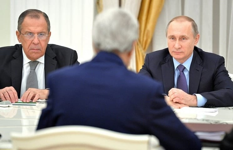 Kerry sitting with Lavrov and Putin in Moscow: Observe the Russians' faces.