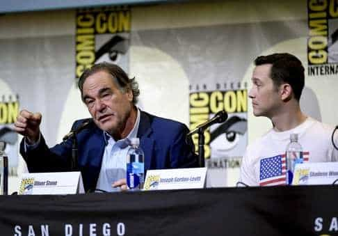 Stone at Comic-con during a press conference. (Fanked by Gordon-Levitt, who plays Snowden).