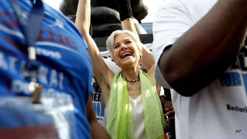 Dr. Jill Stein, presumptive Green Party presidential nominee, waves at a rally in Philadelphia, Wednesday, July 27, 2016, during the third day of the Democratic National Convention. The job of the corporate media is to paint her candidacy as impossible.  (AP Photo/Alex Brandon)