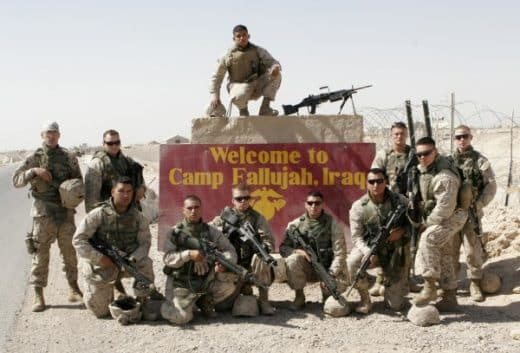 US soldiers posing for a souvenir in Fallujah conquered ground.