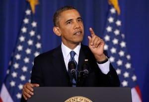 Obama listening to Medea Benjamin