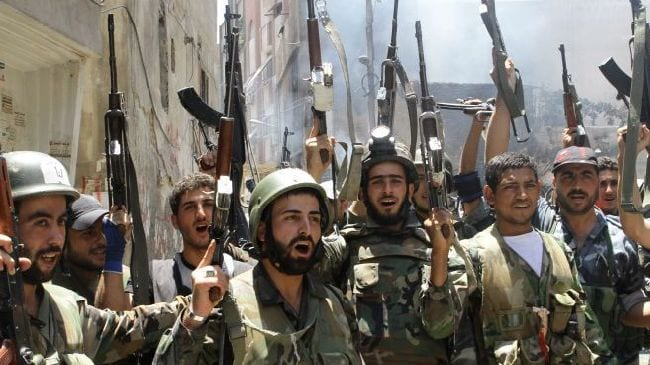 Syrian army soldiers hail the recent victory in Qusayr. Assad still enjoys wide popularity in many sectors of the population, and most Syrians are aware of what awaits them at the hands of NATO proconsuls.