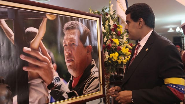 Pres. Maduro before portrait of late Pres Chavez.
