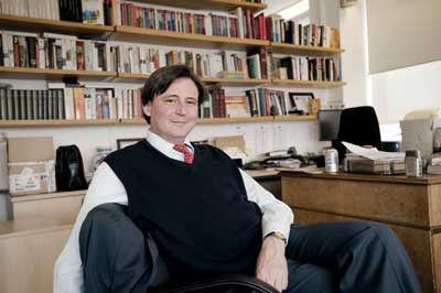 John Micklethwait, sitting pretty in the halls of power while shamelessly promoting war.