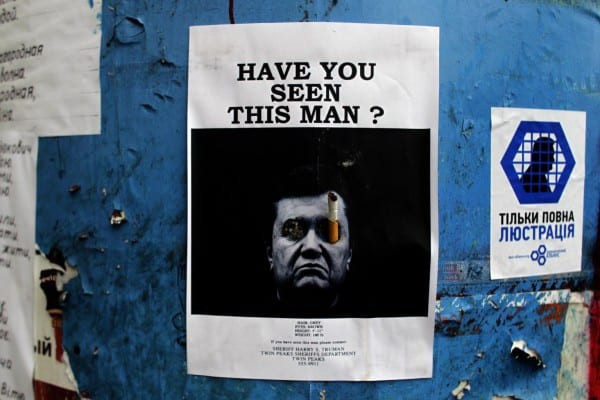 """Wanted poster on Yanukovych bearing the stamp of Western dirty tricks.  First, it's in English. Second, note the """"high production value,"""" are in situations where chaos prevails."""