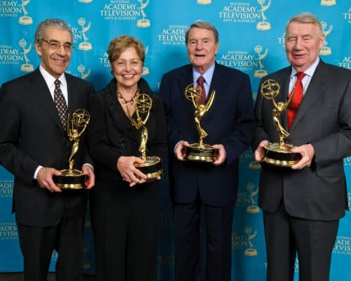 The PBS Newshour crew receiving some awards. For what?