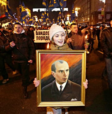 During the Maidan protests, a Jan. 1, 2014 torchlight march in Kiev was held to honor Ukraine's WWII era ultranationalist, Stepan Bandera (1909-1959). 15,000 extremists carried Svoboda party banners and the red and black battle flag of Bandera's paramilitary, the Ukrainian Insurgent Army. (AP Photo by Efrem Lukatsky).
