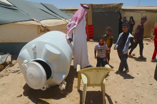 empty water tank - Syrian Beduine refugees outside Zataari camp
