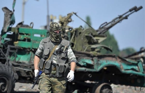 Novorussian soldier near captured equipment.