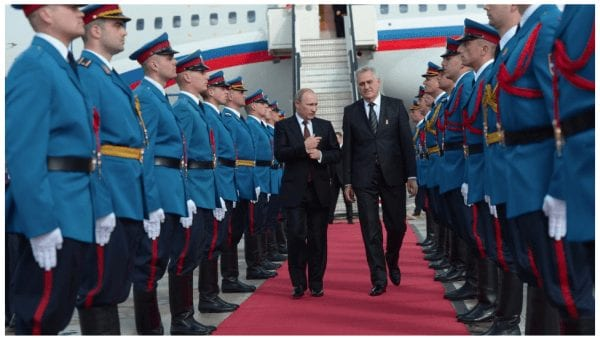 Russian President Vladimir Putin, left, and Serbian President Tomislav Nikolic walk during a welcome ceremony at the airport in Belgrade, Serbia, Thursday, Oct. 16, 2014. (RIA-Novosti / Alexei Nikolsky)